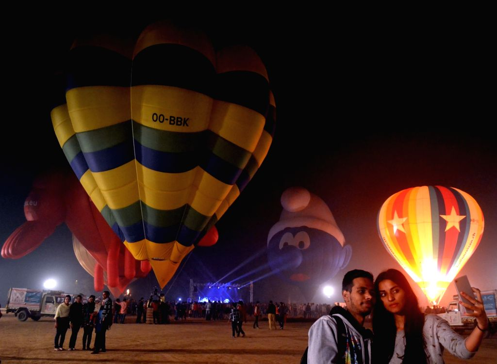 People click selfies during  balloon festival in Agra, on Nov 30, 2016.