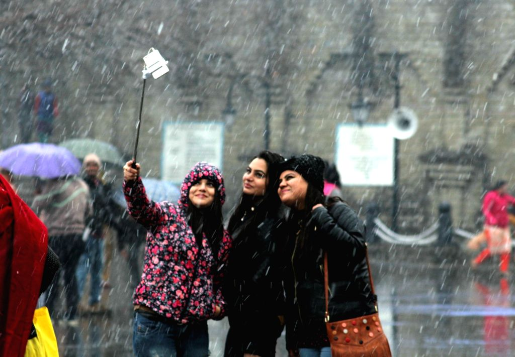People click selfies -self portrait - during snowfall in Shimla on Jan 23, 2018.