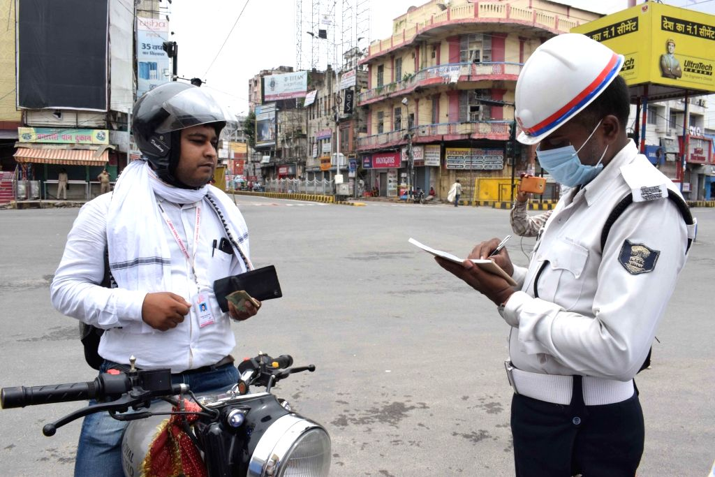 People commuting without wearing face masks being penalised during a complete COVID-19 lockdown re-imposed in Patna, on July 11, 2020.