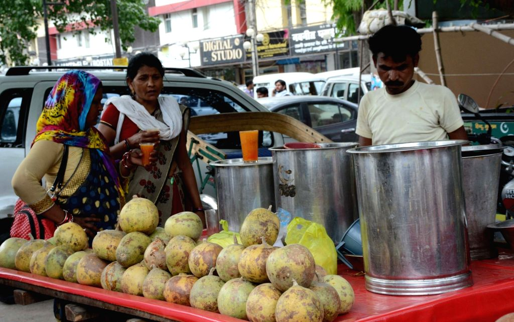 """People cool themselves with """"Sherbets"""" on a hot day. (File Photo: IANS)"""