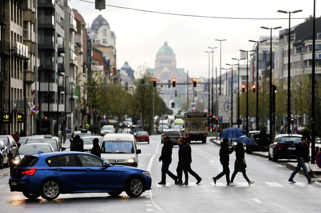 """People cross a road in central Brussels, capital of Belgium, on Nov. 21, 2015. The terror threat level in the Brussels region was increased to """"maximum"""" ... - Charles Michel"""
