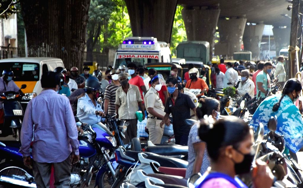 People crowded near KR Market to buy groceries seem to ignore social distancing guidelines during Coronavirus lockdown in the wake of the 2nd wave of COVID-19 in Bengaluru on Sunday 23 May 2021.