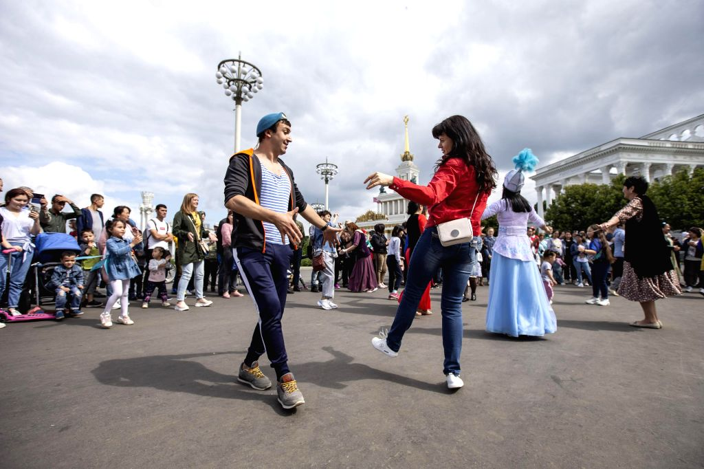 People dance at the Exhibition of Achievements of National Economy (VDNH) in Moscow, Russia, on Aug. 2, 2020. VDNH, an exposition, museum and recreational complex in ...