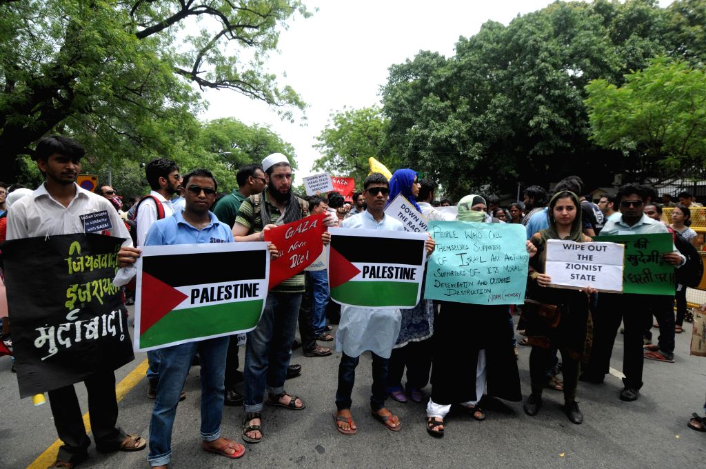 People demonstrate in front of Israeli Embassy in New Delhi against Israeli attacks on Gaza on July 13, 2014.
