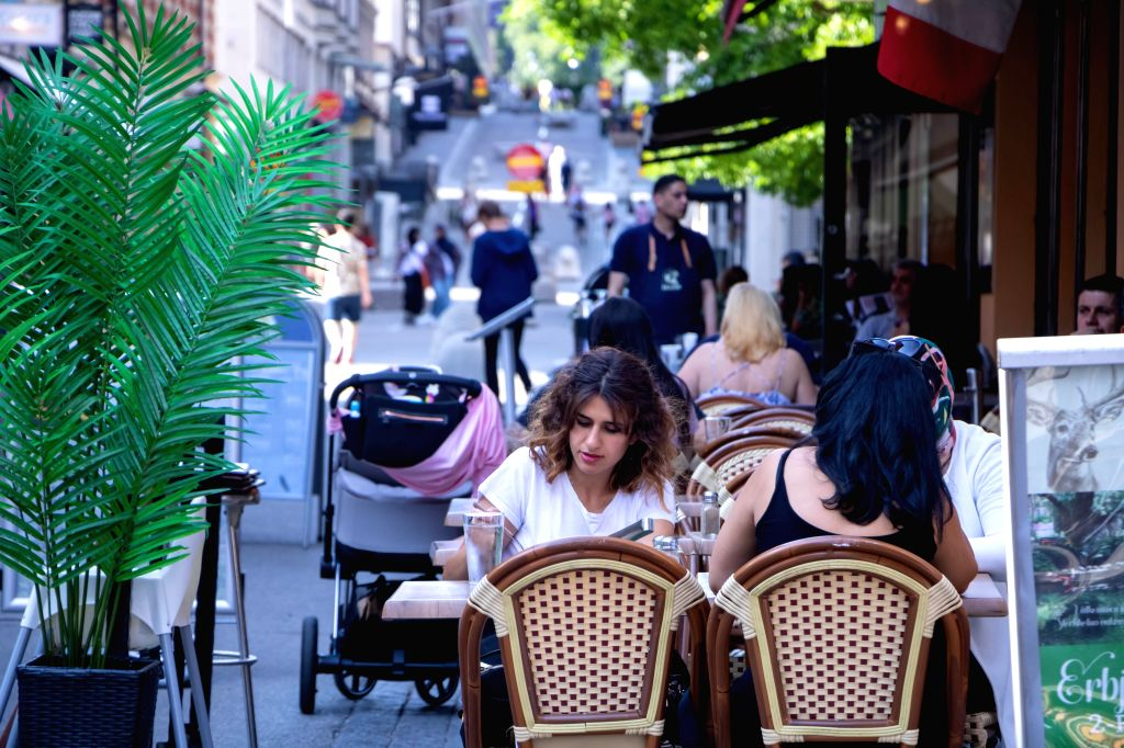 People dine at a restaurant patio in central Stockholm, capital of Sweden, on Aug. 9, 2020. Sweden has counted 5,763 COVID-19 deaths and 82,323 infections as of ...