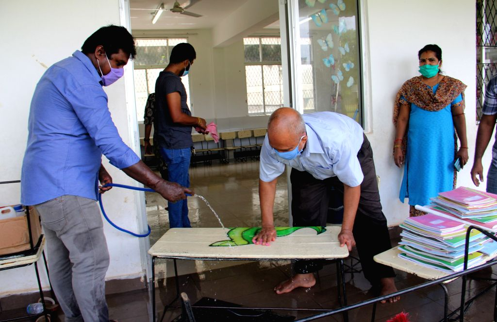 People disinfect a classroom at a school in Colombo, Sri Lanka, on July 4, 2020. Sri Lankan government officially announced that all schools will reopen on July 6 ...