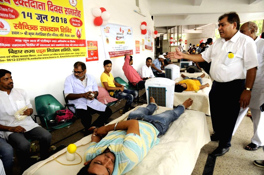 People donate blood at a blood donation camp organised on World Blood Donor Day, in Patna on June 14, 2018.