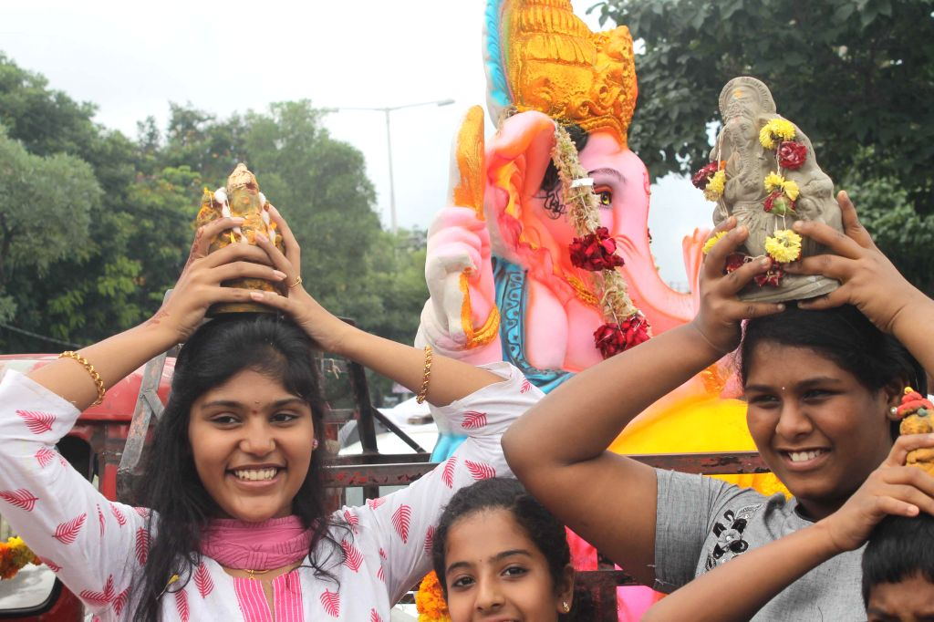 People during immersions of Ganesh idols at Hussain Sagar in Hyderabad  on Aug 31, 2014.