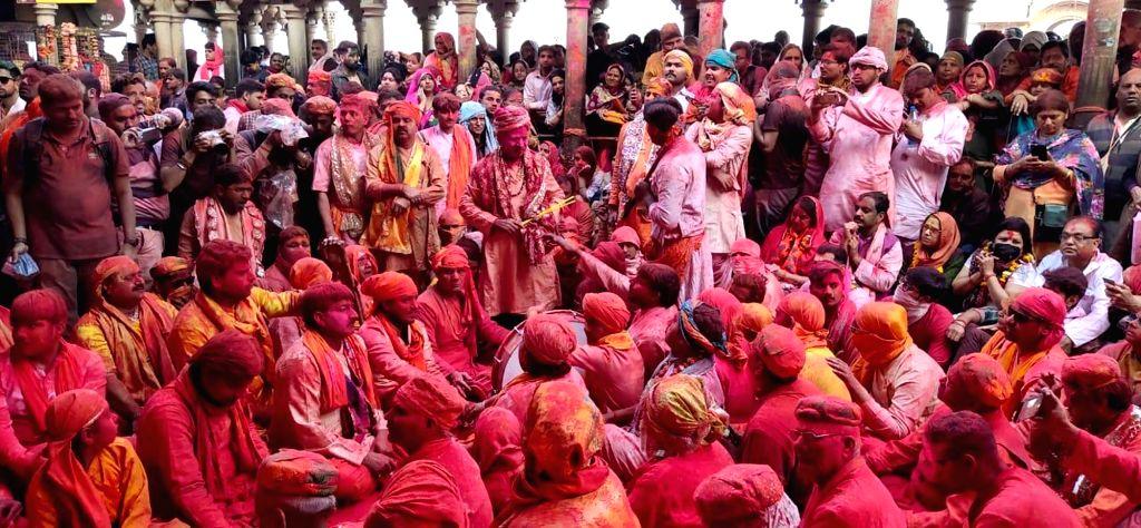 People during 'Laddu Holi' celebrations in Uttar Pradesh's Barsana on March 14, 2019.