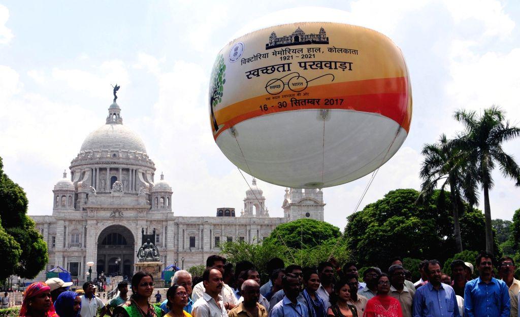 "People during ""Swachhta Pakhwada"" at Victoria Memorial in Kolkata on Sept 16, 2017."