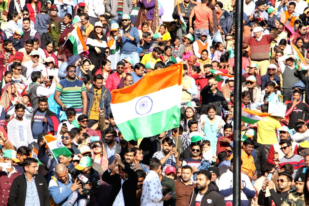 People during the Beating Retreat ceremony at 71st Republic Day celebrations at the India-Pakistan border post at Attari, about 35 kms from Amritsar on Jan 26, 2020.