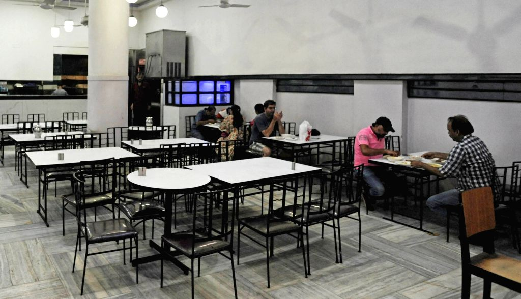 People eat a meal in a restaurant, which re-open today to the public, after the State Government announced relaxations on the ongoing lockdown during the coronavirus pandemic in Kolkata on ...