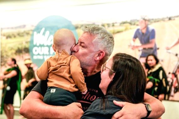 People embrace at the arrival area of an airport in Christchurch, New Zealand, on April 19, 2021.