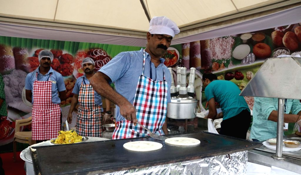 """People enjoy food during """"Bharat Parv"""" ahead of 70th Independence Day celebration at Rajpath in New Delhi on Aug 13, 2016."""