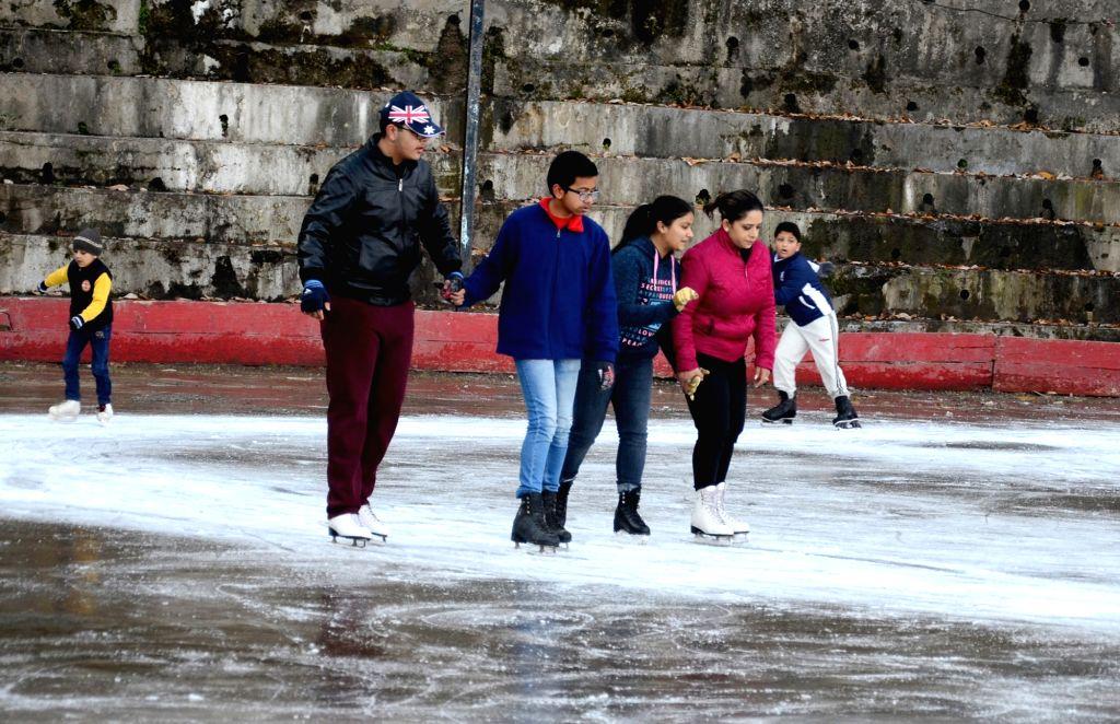 People enjoy ice skating at natural ice skating rink at Lakkar Bazaar in Shimla, on Dec 10, 2018. (Photo: IANS(