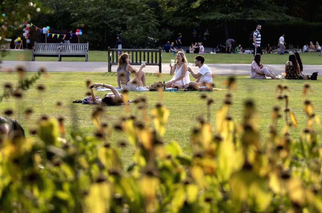 People enjoy leisure time at Regent's Park in London, Britain on July 31, 2020.