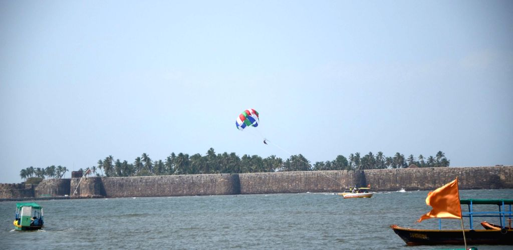 People enjoy paragliding at Sindhudurg Fort in Malvan, Sindhudurg district of Maharashtra on May 28, 2017.