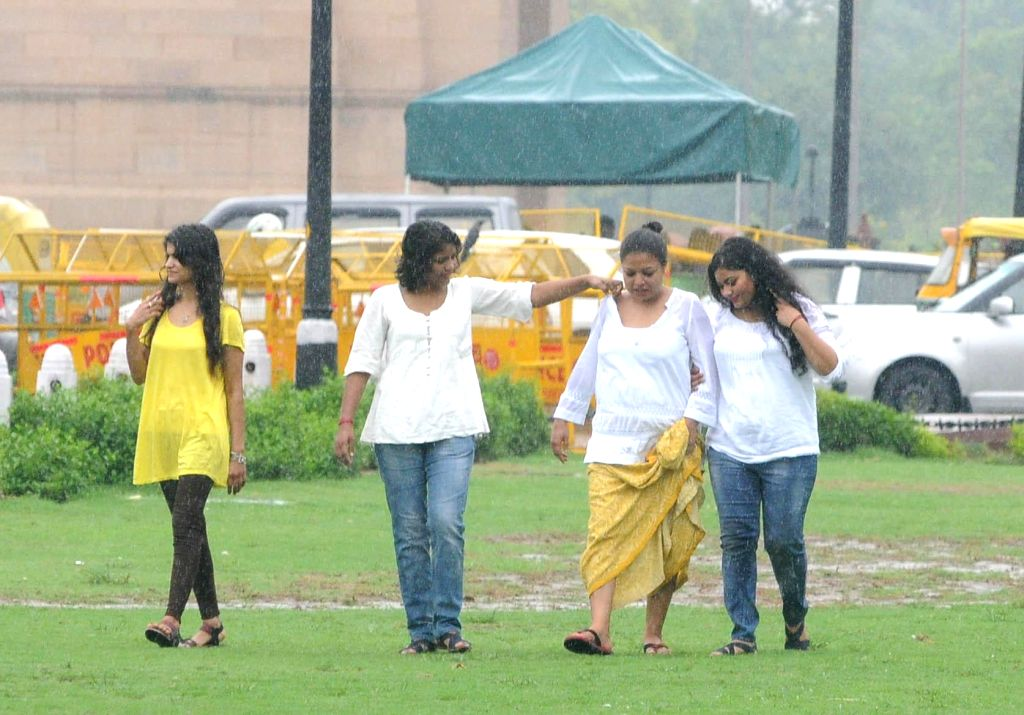 People enjoy rains in New Delhi on July 18, 2014.