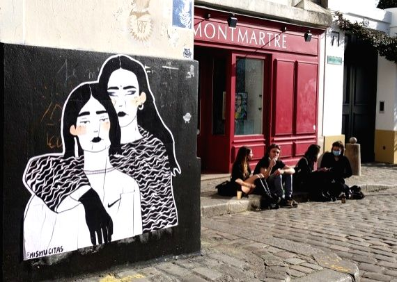 People enjoy the sunshine at the Montmartre in Paris, France, Feb. 24, 2021.