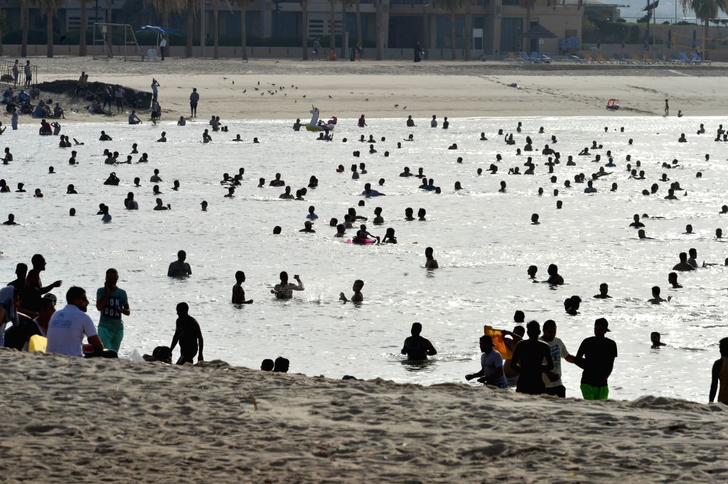 People enjoy their time at a beach during the first day of Eid al-Adha in Hawalli Governorate, Kuwait, on July 31, 2020. As life is gradually returning to ...