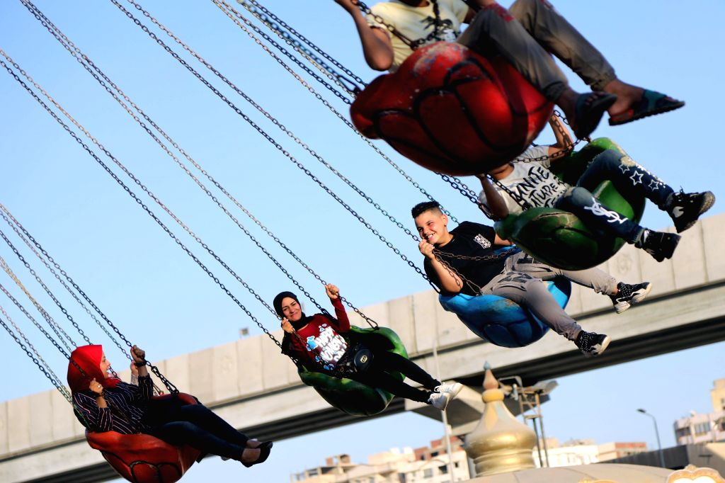 People enjoy their time during the holiday of Eid al-Adha in Cairo, Egypt, on Aug. 2, 2020.