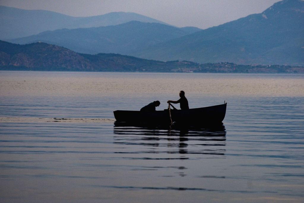 People enjoy their time on a boat on the Ohrid Lake in Struga, North Macedonia, on Aug. 13, 2020.   The number of tourists in North Macedonia in June this year ...