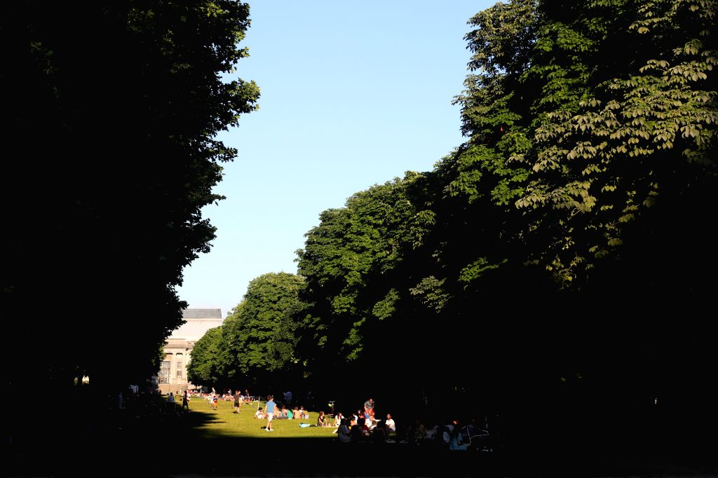 People enjoy themselves at the Cinquantenaire Park in Brussels, Belgium, on June 25, 2020. Belgian Prime Minister Sophie Wilmes announced here Wednesday the ... - Sophie Wilmes