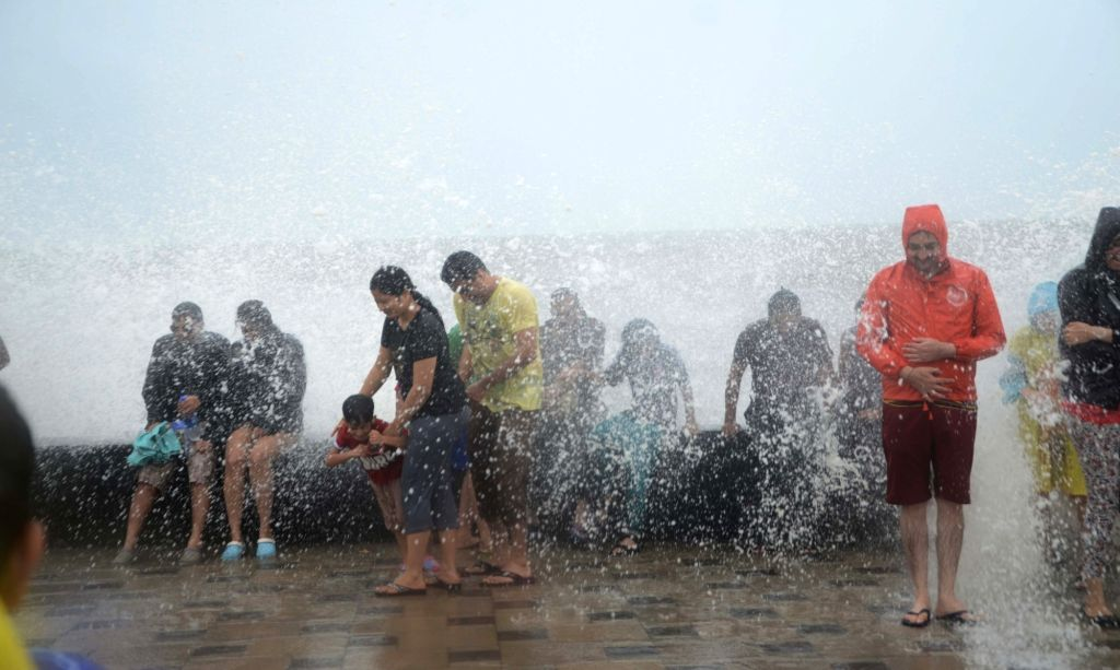 People enjoy themselves at Worli, in Mumbai on July 3, 2016.
