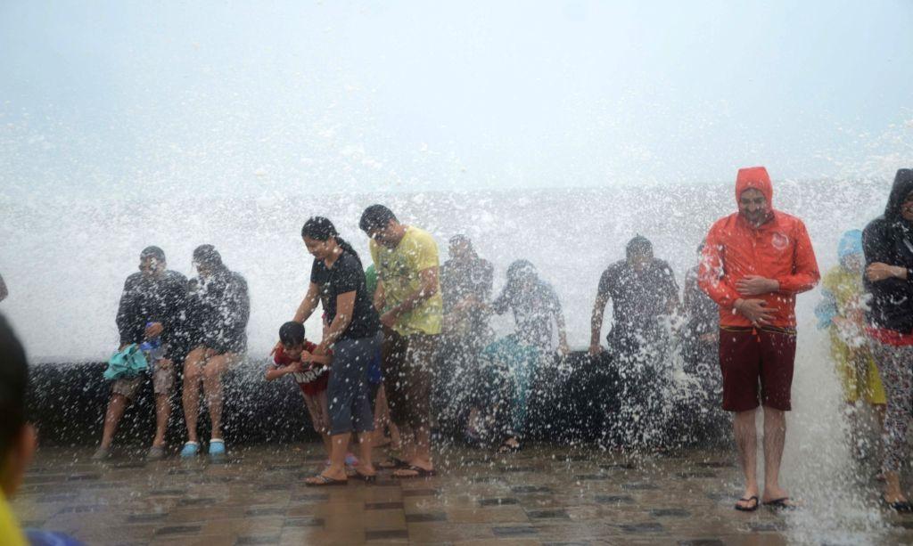 People enjoy themselves at Worli, in Mumbai on July 3, 2016.