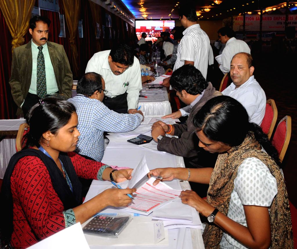 People file Income Tax Returns on the penultimate day of filing IT Returns at Income Tax mela organised at Palace Grounds in Bangalore on July 30, 2014.
