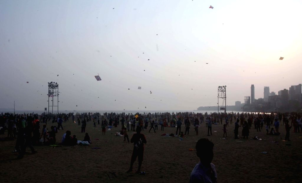 People fly kites at on the iconic beach front of Girgaum Chowpatty on Makar Sankranti in Mumbai, on Jan 14, 2017.