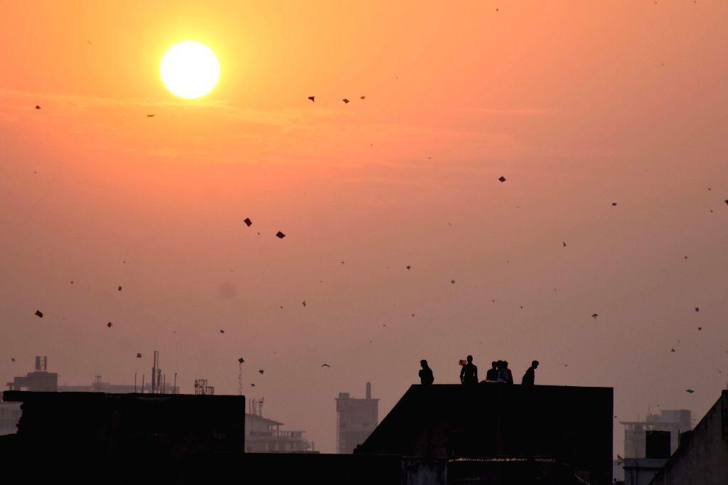 People fly kites in Jaipur on Makar Sankranti, on Jan 14, 2017.