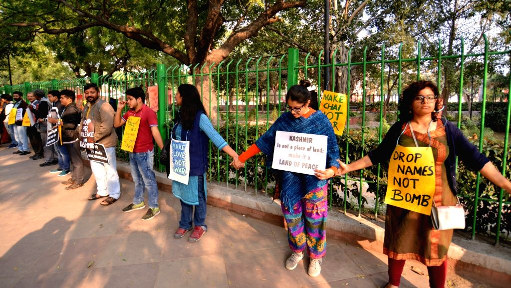 People form a human chain against war in New Delhi, on March 4, 2019.