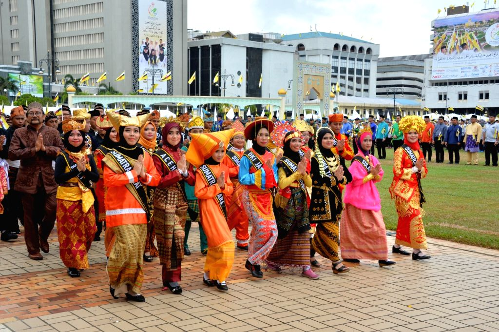 People from different Bruneian communities take part in the 35th National Day celebration in Bandar Seri Begawan, capital of Brunei, Feb. 23, 2019. ...