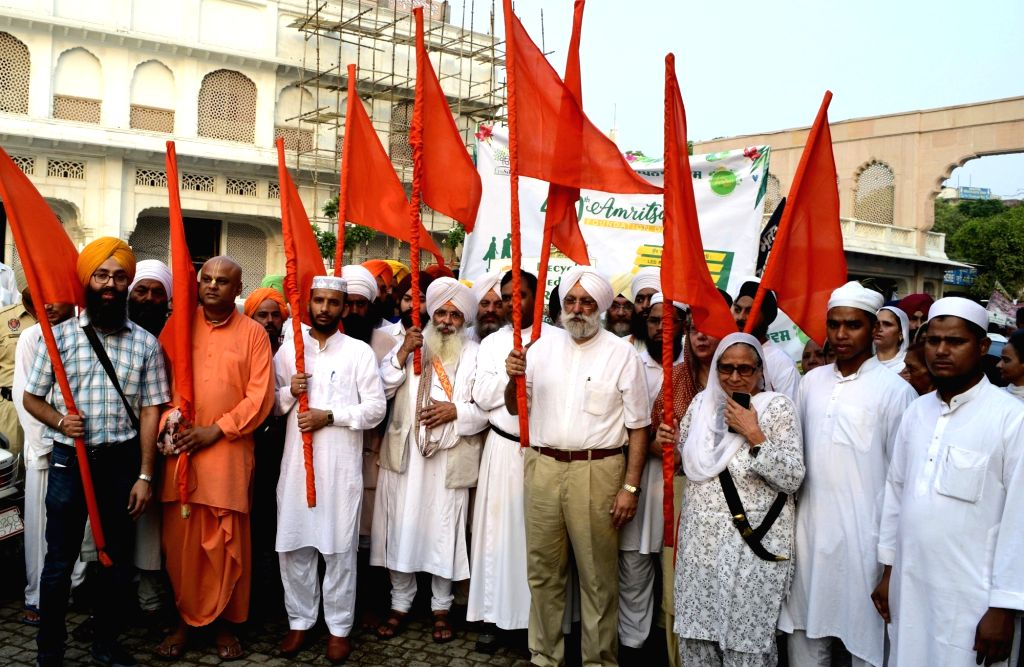 People from different relegions participate in a march organised to mark Amritsar Foundation Day on June 27, 2017.