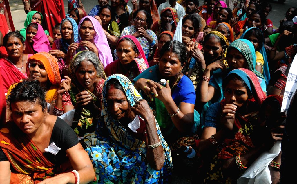 People from Gujarat, Jharkhand, Chhattisgarh, Delhi, West Bengal and Uttar Pradesh stage a demonstration to press for implementation of National Food Security Act,2013 at Jantar Mantar in New Delhi ..