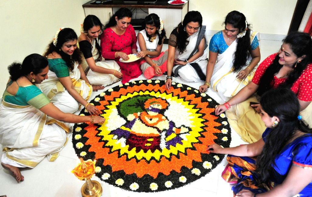 People from Kerala makes Pookalam while celebrating the eve of Thiru Onam festival, in Bengaluru on Sunday 30th August 2020.