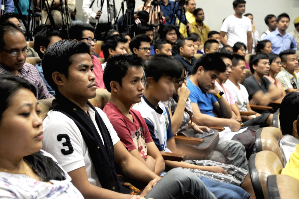 People from North-Eastern states of India attend an interactive review meeting for their safety and security at Hindi Bhawan in New Delhi on May 9, 2014.