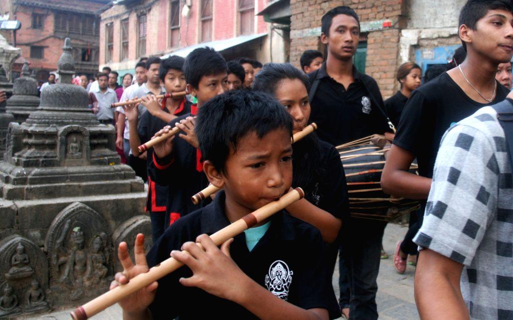 People from the Newar community play the traditional music during the Gunla parva festival at Swayambhunath, Kathmandu, Nepal, Aug. 15, 2015. Gunla, the tenth ...