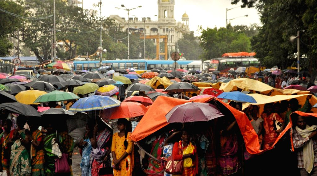 People from various tribal communities stage a demonstration to press for their demands during rains, in Kolkata on Sep 24, 2019.