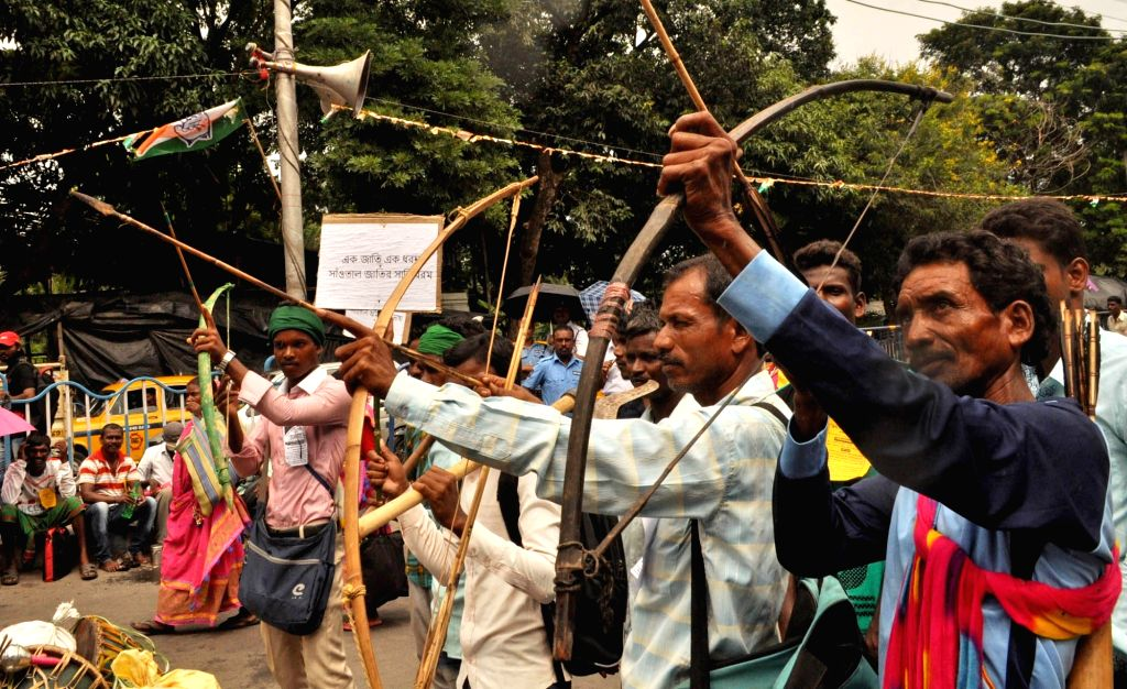 People from various tribal communities stage a demonstration to press for their demands, in Kolkata on Sep 24, 2019.