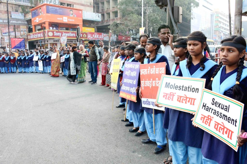 People from various walks of life participate in a demonstration against increasing incidents of crimes against women, in Patna on Dec 3, 2019.