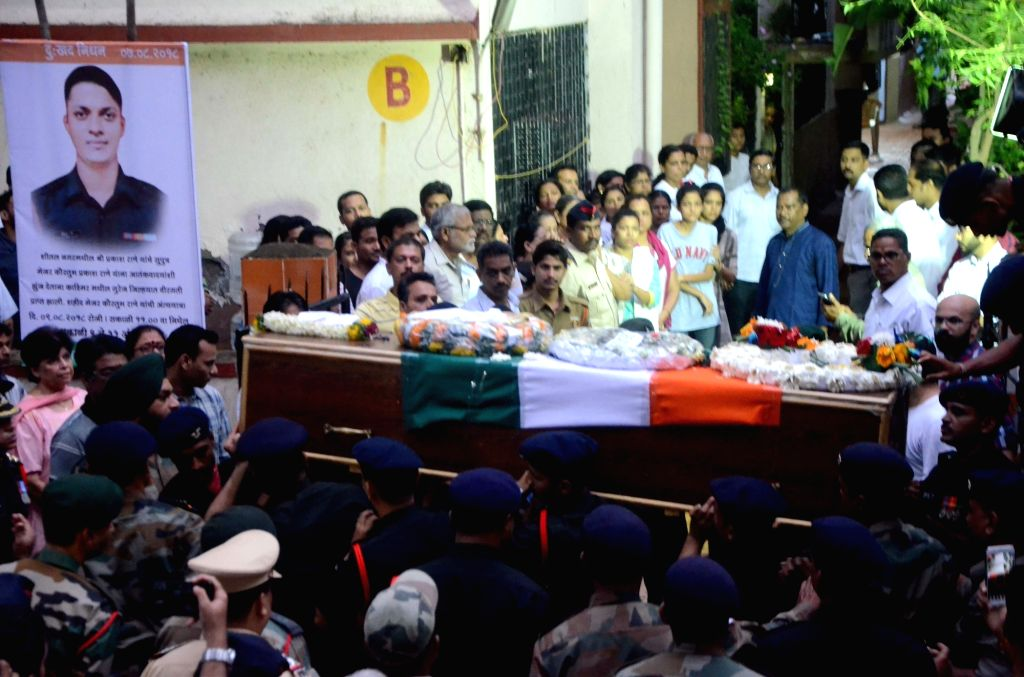 People gather around the mortal remains of Major Kaustubh P. Rane who was killed in a gun battle in Jammu and Kashmir; that reached his residence in Maharashtra's Thane on Aug 9, 2018.