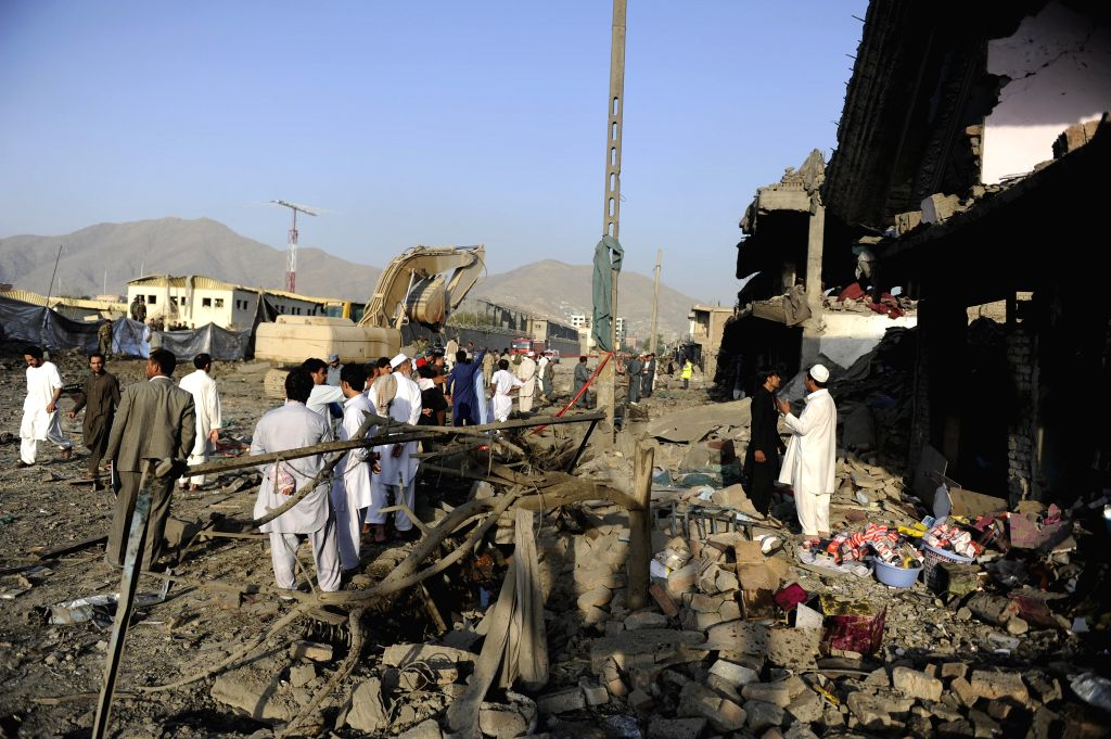 People gather at a blast site in Kabul, capital of Afghanistan, Aug. 7, 2015. At least 8 civilians were killed and nearly 400 other wounded in a truck bomb attack in ...