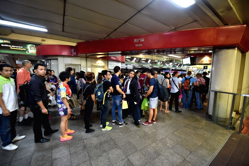 People gather at a BTS Sky Train station near the site of an explosion in downtown Bangkok, capital of Thailand, on Aug. 17, 2015. At least 15 people were killed ...