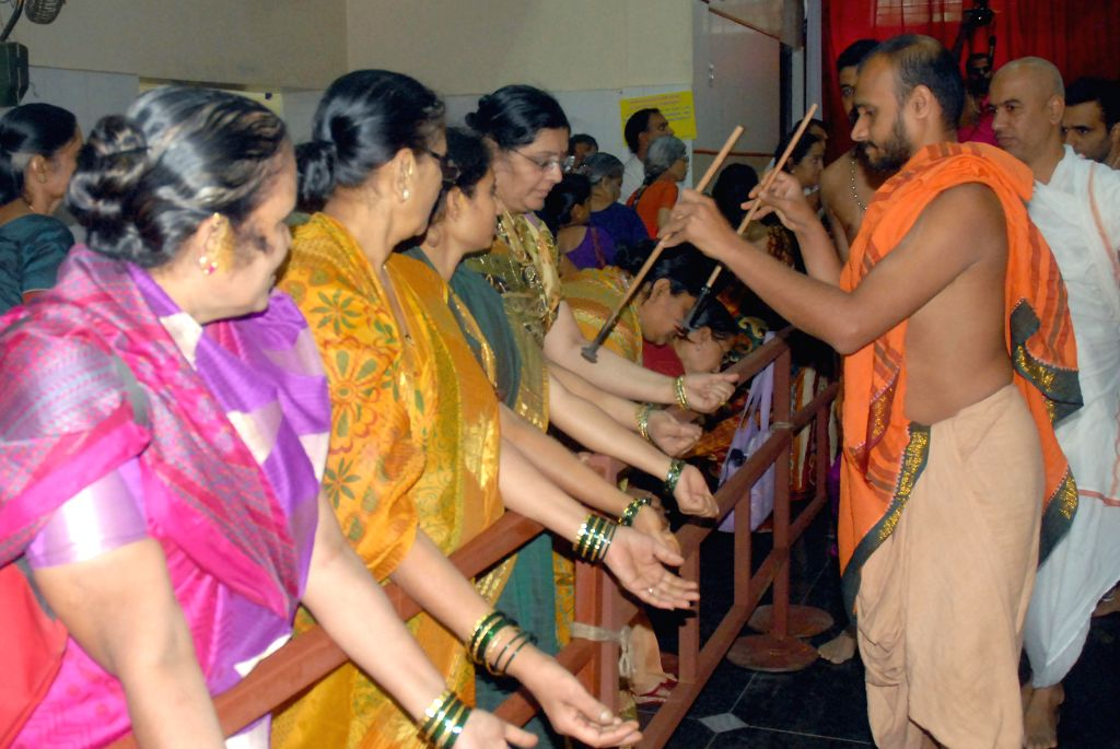 People gather at a temple on the occasion of Prathama Ekadashi at Basvanagudi in Bangalore on July 8, 2014.
