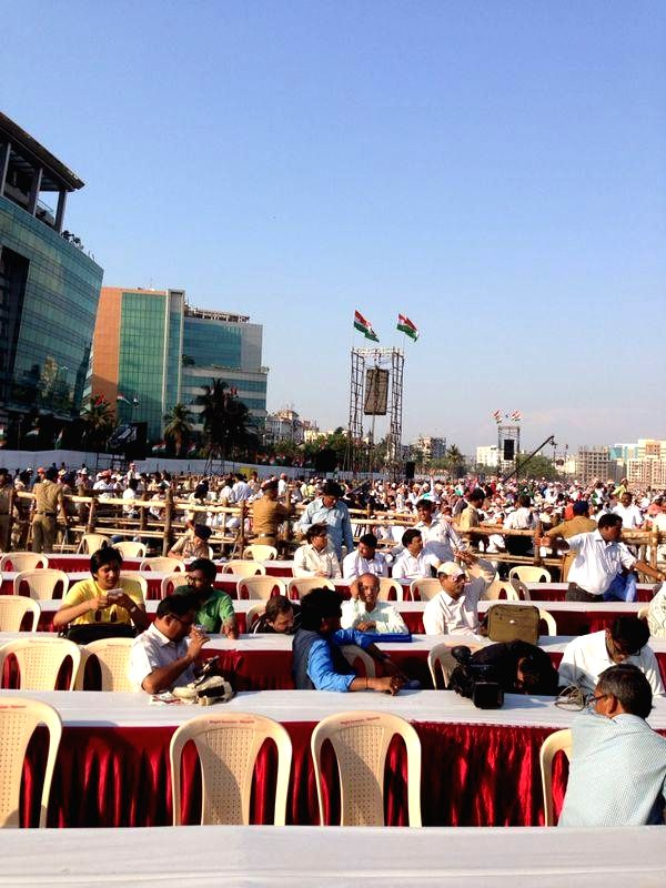 People gather at BKC Ground in Bandra to attend Congress vice president Rahul Gandhi's rally in Mumbai on April 20, 2014.