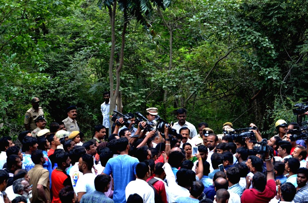People gather at Jnanabharathi Police Station campus where G. Parameshwara's aide N.S. Ramesh committed suicide earlier in the day citing alleged harassment in connection with tax raids on ...