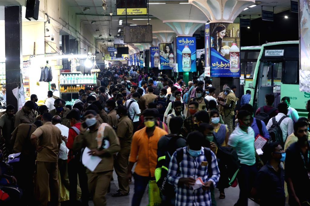 People gather at Koyambedu bus stand to board buses to their respective hometowns on the eve of Diwali, in Chennai on Nov 13, 2020.