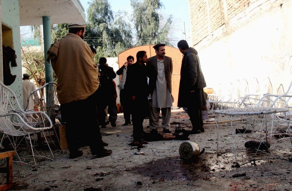 People gather at the blast site in Nangarhar province, Afghanistan, Jan. 17, 2016. About 12 people were killed and 13 others wounded after a suicide bombing ...